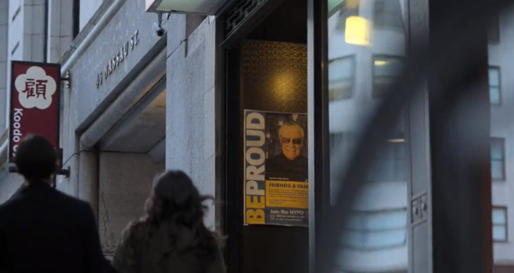 Scene from Netflix show featuring Stan Lee as an NYPD cop on a poster in New York City