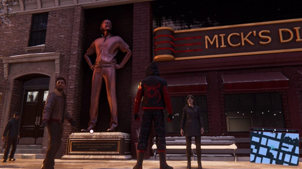 Bronze statue of Stan Lee outside Micks Diner in the video game Spider-Man: Miles Morales