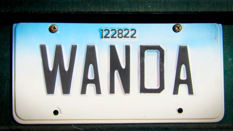 License plate with the word Wanda and the numbers 122822 on top from the Disney+ show WandaVision