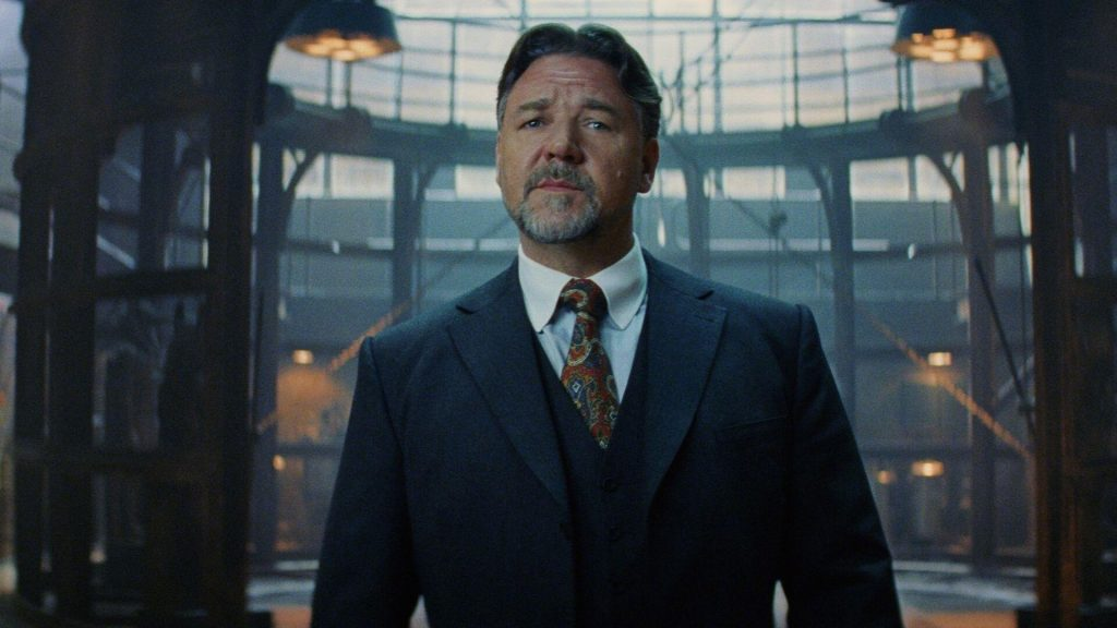 Russell Crowe in a dark suit and red designed tie in the movie Unhinged.