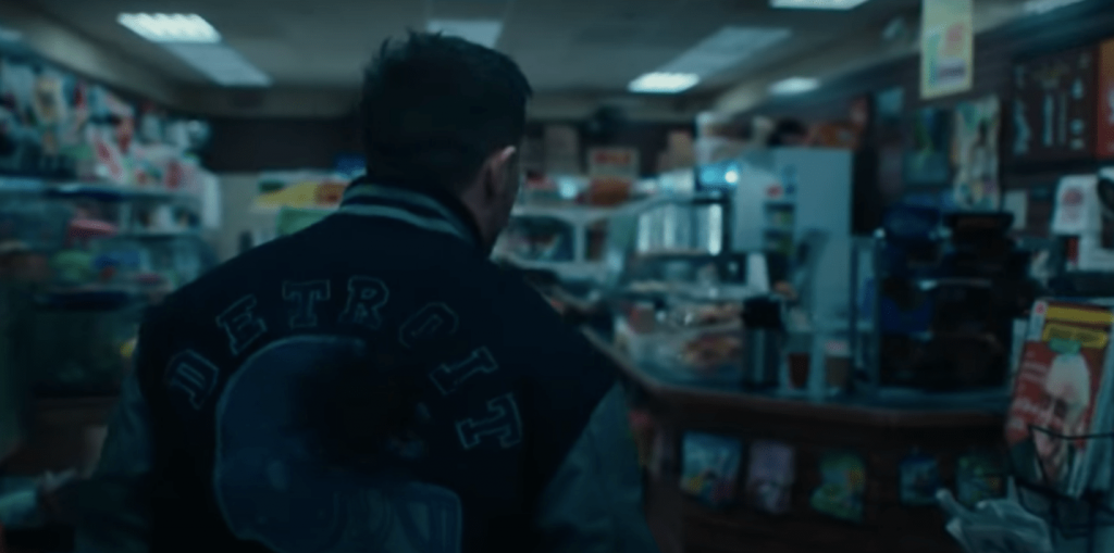 Tom Hardy in the Venom 2 trailer passes an image of Stan Lee on a magazine cover