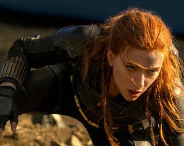 Scarlett Johansson crouches down in a black uniform in Black Widow