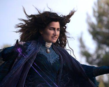 Kathryn Hahn in a dark blue cloak casting a spell in WandaVision